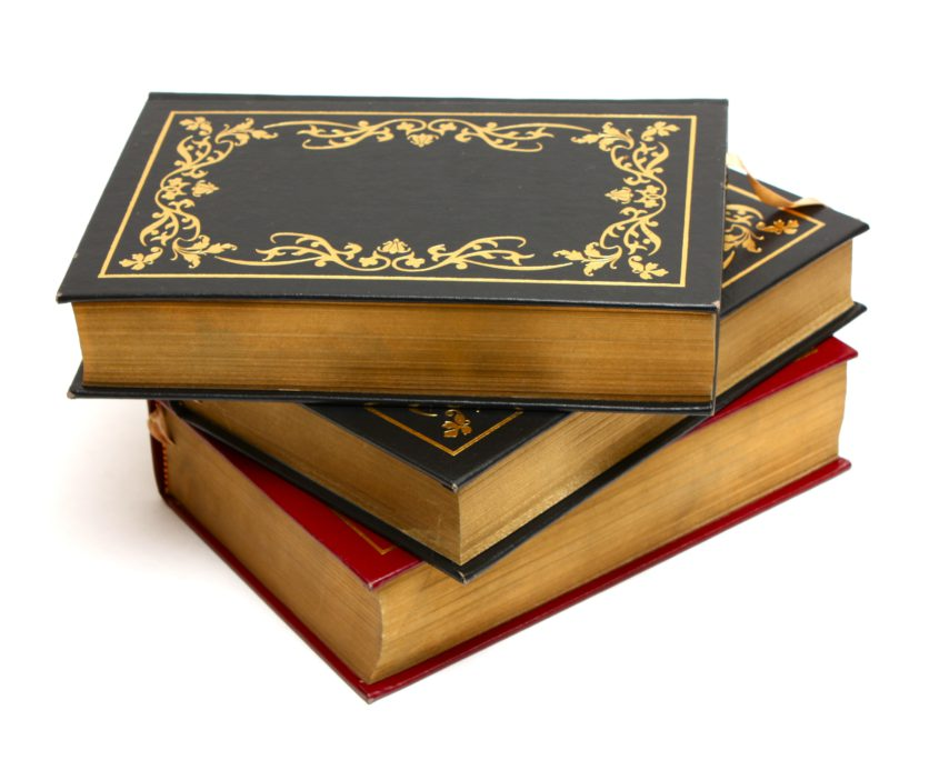 12386 an stack of old books isolated on a white background or